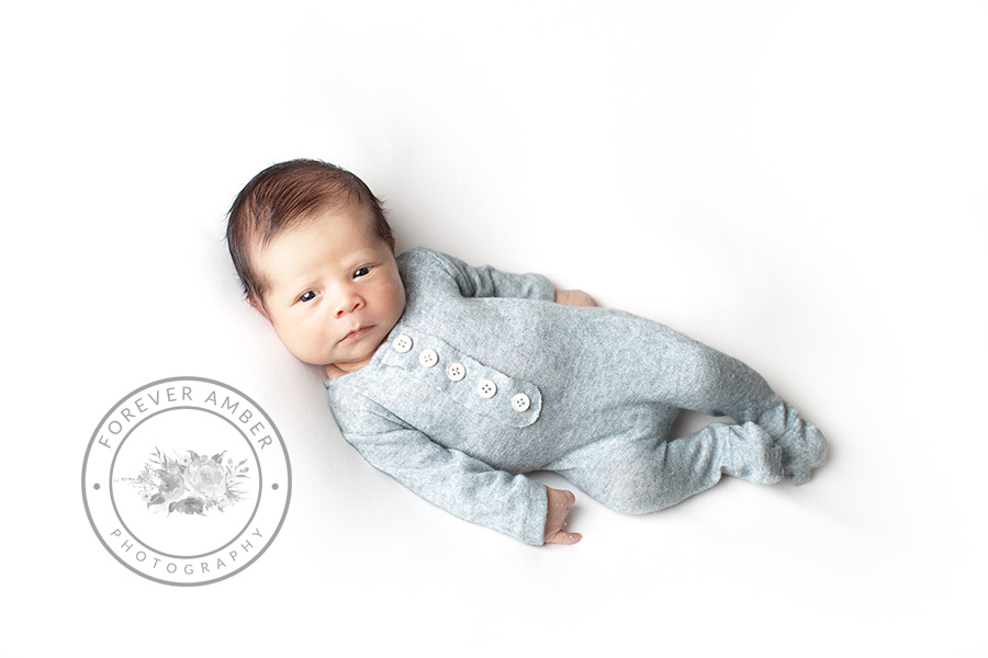 <alt>newborn in blue pajama